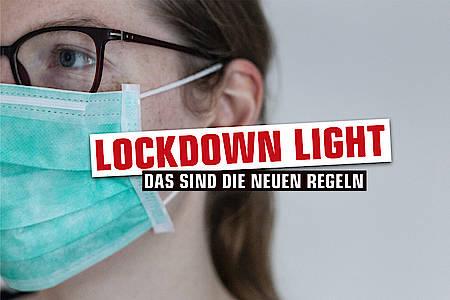 lockdown-regeln-kreis-herford-frau-maske
