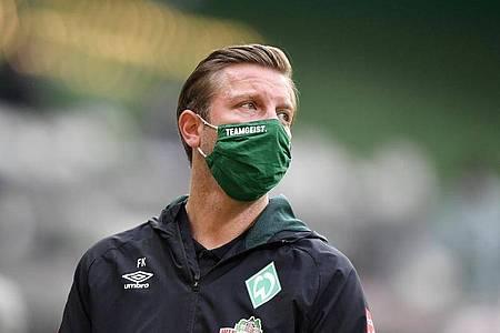 Für Trainer Florian Kohfeldt und Werder Bremen geht es beim Abstiegsduell in Mainz um «alles». Foto: Martin Meissner/AP-Pool/dpa