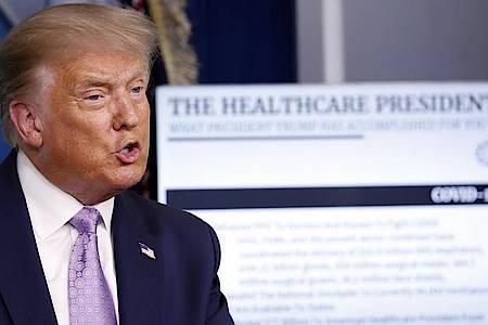 Donald Trump, Präsident der USA, spricht während einer Pressekonferenz im Weißen Haus über das Coronavirus. Foto: Andrew Harnik/AP/dpa