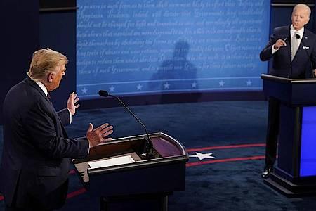 US-Präsident Donald Trump (l) und Herausforderer Joe Biden liefern sich einen Schlagabtausch. Foto: Morry Gash/AP Pool/dpa
