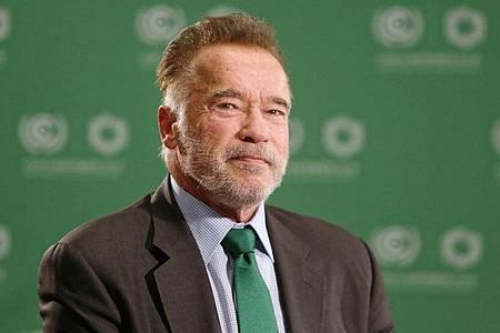 Arnold Schwarzenegger wirbt fürs Impfen. Foto: Andrzej Grygiel/PAP/dpa
