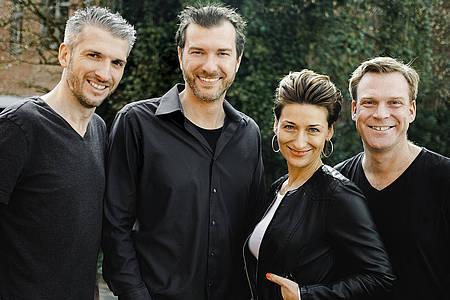 Gruppenfoto der vier von hier