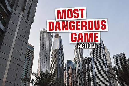 """Großstadt und Hochhäuser mit Aufschrift """"Most Dangerous Games"""""""